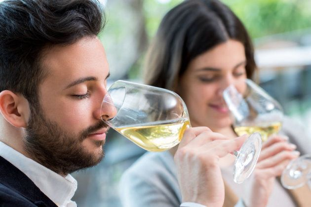 56695248 - close up portrait of young couple tasting white wine