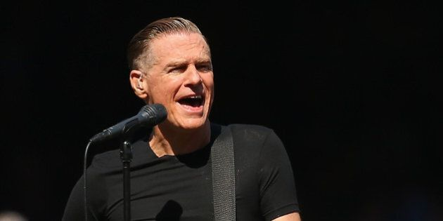 MELBOURNE, AUSTRALIA - OCTOBER 03: Bryan Adams performs during the 2015 AFL Grand Final match between...