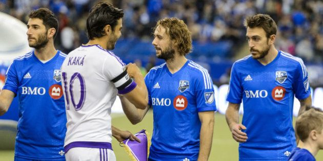 MONTREAL, QC - MARCH 28: Kaka #10 of Orlando City SC shakes hands with Marco Donadel #33 of Montreal...