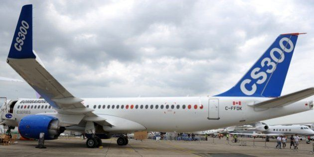 The Canadian Bombardier Commercial Aircraft's new jetliner Bombardier CS300 is pictured on the tarmac on the day of the presentation of the new Bombardier CSeries aircrafts a day prior to the opening of  the International Paris Airshow at Le Bourget on June 14, 2015. AFP PHOTO / ERIC PIERMONT        (Photo credit should read ERIC PIERMONT/AFP/Getty Images)