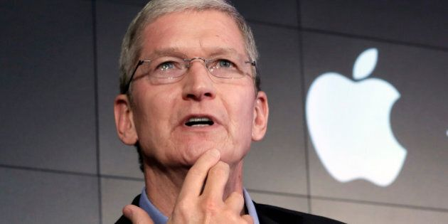 FILE - In this April 30, 2015, file photo, Apple CEO Tim Cook responds to a question during a news conference...