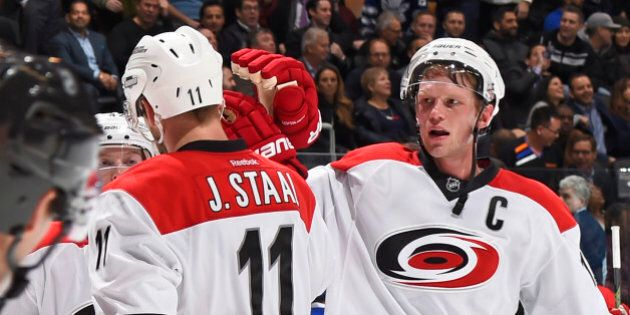 TORONTO, ON - JANUARY 21: Jordan Staal #11 and Eric Staal #12 of the Carolina Hurricanes celebrate the...