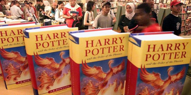 Malaysian readers queue up to buy the latest Harry Potter books by British author J.K. Rowling at a bookstore...