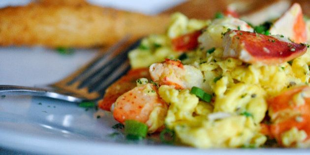 Fluffy scrambled eggs cooked with lobster meat, green onions, white queso, topped with diced tomatoes....