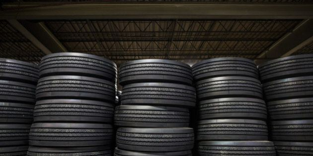 Bridgestone Corp. tires sit stacked at a warehouse in Nashville, Tennessee, U.S., on Tuesday, Dec. 29,...