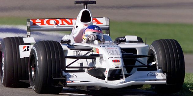 INDIANAPOLIS, UNITED STATES: Jacques Villeneuve of Canada takes his BAR Honda through a turn during the practice session 29 September, 2001 at the US Grand Prix at the Indianapolis Motor Speedway in Indianapolis, IN. The race will be held on 30 September. AFP PHOTO/Jeff HAYNES (Photo credit should read JEFF HAYNES/AFP/Getty Images)