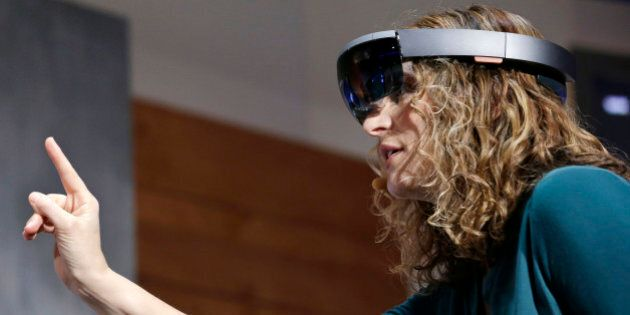 In this Jan. 21, 2015 photo, Microsoft's Lorraine Bardeen demonstrates HoloLens headset during an event...