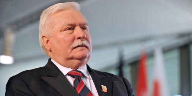 Former Poland president Lech Walesa (foreground) arrives to take part in the commemoration of the 220th...