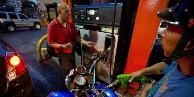 A motorcyclist fuels up at a gas station in Caracas, Venezuela, Wednesday, Feb. 17, 2016. Venezuela's...