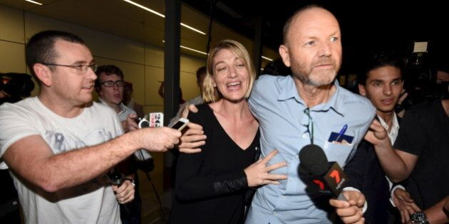 Australian 60 Minutes journalist Tara Brown (C) and 60 Minutes producer Stephen Rice arrive at Sydney...