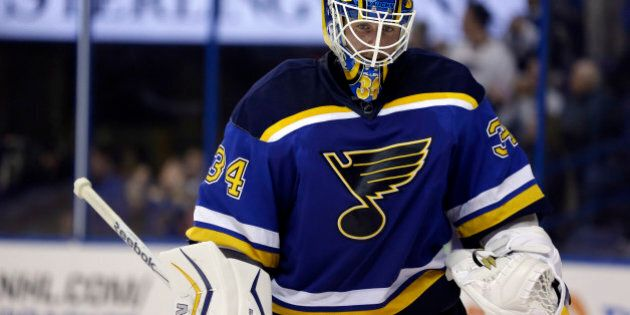 St. Louis Blues goalie Jake Allen pauses during a timeout during the third period of an NHL hockey game against the Calgary Flames Thursday, April 2, 2015, in St. Louis. The Blues won 4-1. (AP Photo/Jeff Roberson)