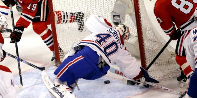 Chicago Blackhawks right wing Marian Hossa, right, scores against Montreal Canadiens goalie Ben Scrivens...