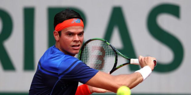 PARIS, FRANCE - MAY 27: Milos Raonic of Canada hits a backhand during the Men's Singles third round match...