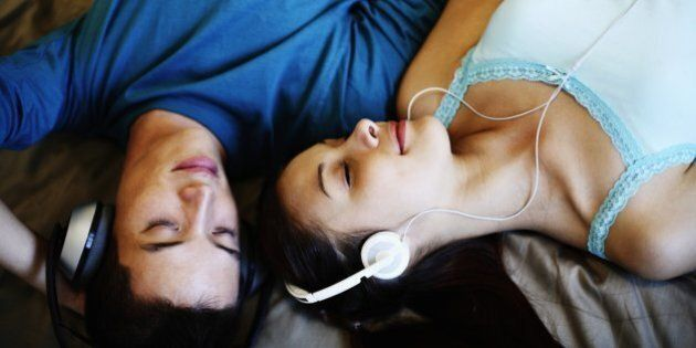 Young Couple Listening to MP3