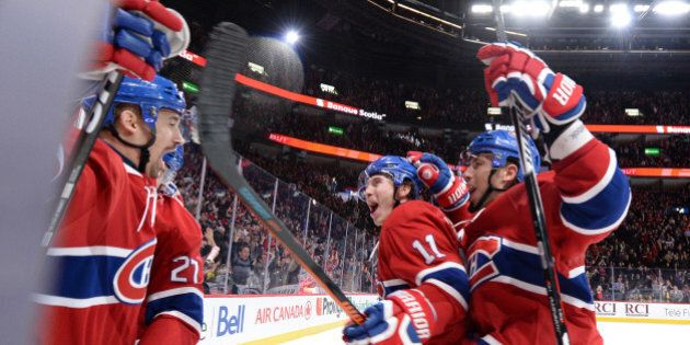 MONTREAL, QC - FEBRUARY 9:Tomas Plekanec #14 of the Montreal Canadiens celebrates after scoring a goal...