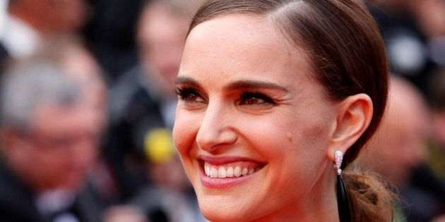 Actress Natalie Portman poses for photographers as she arrives for the screening of the film Sicario...