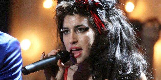 U.S. musician Mark Ronson and British singer Amy Winehouse perform at the Brit Awards 2008 in London,...