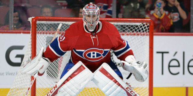 MONTREAL, QC - OCTOBER 17: Carey Price #31 of the Montreal Canadiens warms up prior to the game against...