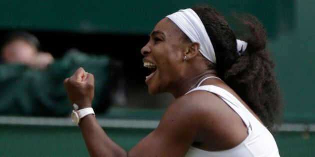 Serena Williams of the United States celebrates winning the singles match against Victoria Azarenka of...