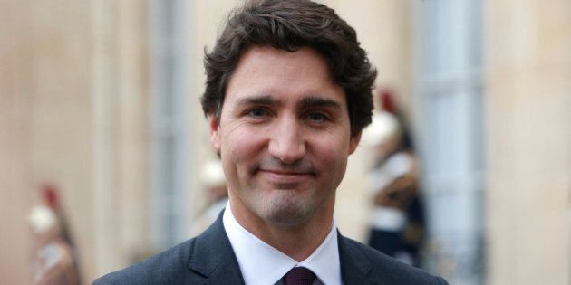 Canadian Prime Minister Justin Trudeau answers media after a meeting, at the Elysee Palace, in Paris,...