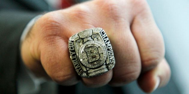 A member of the NHL Boston Bruins hoceky team staff displays his championship ring, Monday, Jan. 23,...