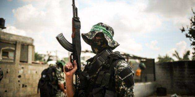 KHAN YUNIS, GAZA - OCTOBER 10: Izz ad-Din al-Qassam Brigades stand guard during a funeral ceremony held...