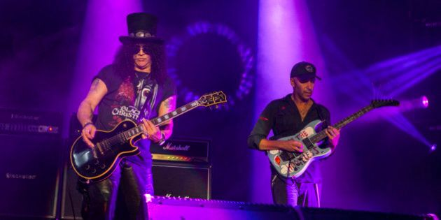 Slash and Tom Morello perform with Ozzy Osbourne at the Voodoo Music Experience on Saturday, Oct. 31, 2015, in New Orleans. (Photo by Barry Brecheisen/Invision/AP)