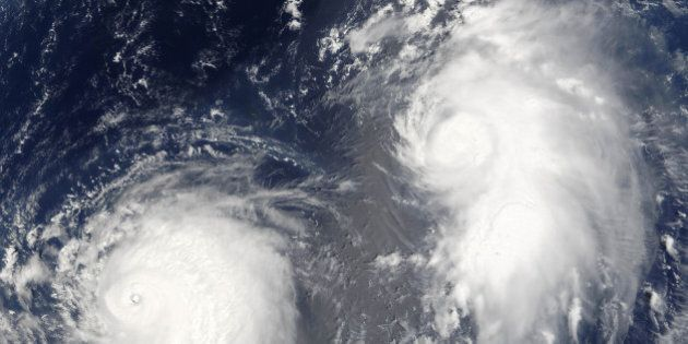 Typhon Mawar (left) and Tropical Cyclone Guchol (right) on 22 August 2005, far out in the northwestern...