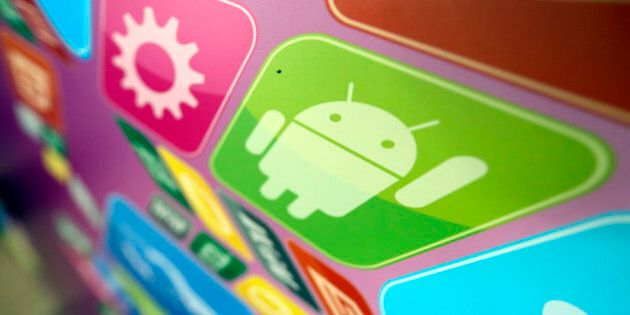 A logo for Google Inc.'s Android operating system is displayed on an advertising sign during the Apps...