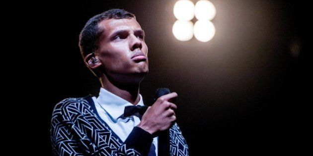 Belgian singer Stromae performs during the 'Lowlands' music festival in Biddinghuizen, on August 16, 2014. The annual event, one of the biggest music festival in The Netherlands, runs until August 17, 2014. AFP PHOTO/ANP/ FERDY DAMMAN netherlands out         (Photo credit should read Ferdy Damman/AFP/Getty Images)