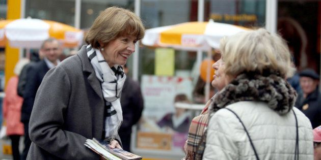 In this Friday, Oct. 16, 2015 photo independent candidate for the mayor of Cologne Henriette Reker talks...