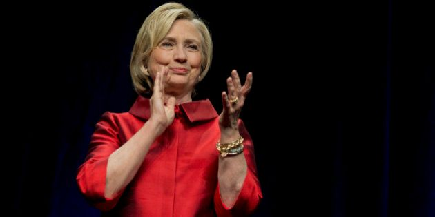 Democratic presidential candidate Hillary Rodham Clinton responds to the cheers of supporters at a Jefferson...