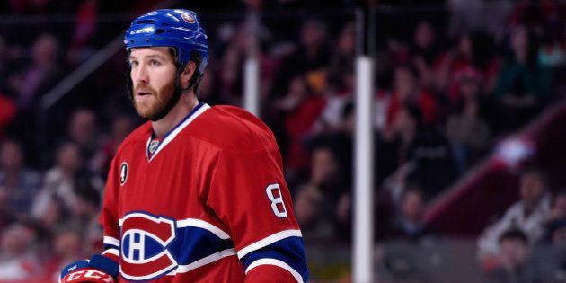MONTREAL, QC - DECEMBER 18: Brandon Prust #8 of the Montreal Canadiens waits for a face-off during the...