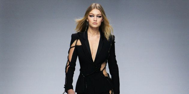 Model Gigi Hadid wears a creation as part of Versace's spring- summer 2016 Haute Couture fashion collection presented in Paris, Sunday, Jan. 24, 2016. (AP Photo/Thibault Camus)