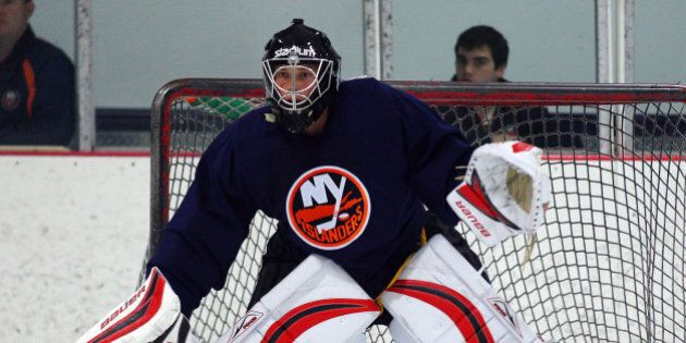 SYOSSET, NY - JULY 12: Goaltender Andres Nilsson #35 defends the net during the prospect mini-camp open...