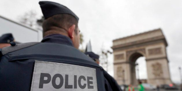 Police forces patrol near the landmark, the Arc de Triomphe, in Paris, Tuesday, Nov. 17, 2015. France's...