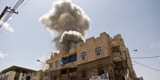 FILE - In this Sunday, May 10, 2015 file photo, Smoke rises from a house of former Yemeni president Ali Abdullah Saleh after a Saudi-led airstrike in Sanaa, Yemen. (AP Photo/Hani Mohammed, File)