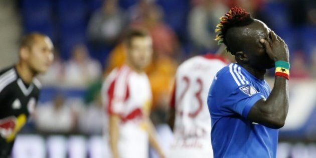 Montreal Impact forward Dominic Oduro reacts after missing a shot against the New York Red Bulls during...