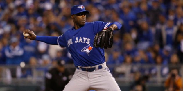 Toronto Blue Jays relief pitcher LaTroy Hawkins throws against the Kansas City Royals during the eighth...