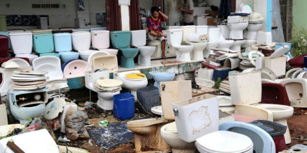A vendor selling used toilets waits for customers at a market in Jakarta, Indonesia Wednesday, March,...