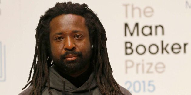 Author Marlon James poses with his book 'A Brief History of Seven Killings' on stage at the Royal Festival...