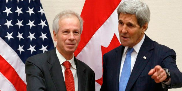 Canadian Foreign Minister Stephane Dion (L) meets with U.S. Secretary of State John Kerry alongside NATO...
