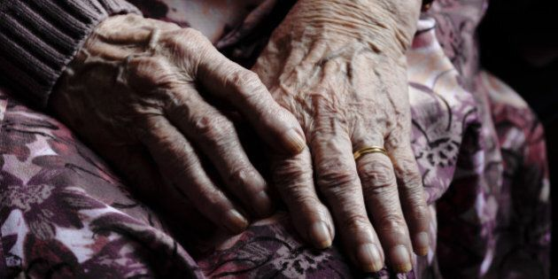 old hands of lady in care