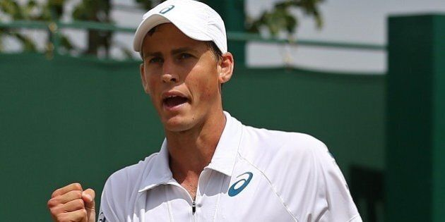 Canada's Vasek Pospisil celebrates winning a point against Serbia's Viktor Troicki during their men's singles fourth round match on day seven of the 2015 Wimbledon Championships at The All England Tennis Club in Wimbledon, southwest London, on July 6, 2015.   RESTRICTED TO EDITORIAL USE  -- AFP PHOTO / JUSTIN TALLIS        (Photo credit should read JUSTIN TALLIS/AFP/Getty Images)