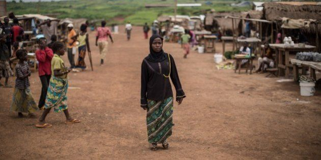 A Muslim refugee form Central African Republic, walks along a street at the Mole refugee camp, 35 Kms...