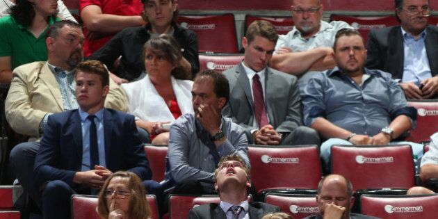 SUNRISE, FL - JUNE 27:  Attendees show a range of emotions during the final round of the 2015 NHL Draft at BB&T Center on June 27, 2015 in Sunrise, Florida.  (Photo by Bruce Bennett/Getty Images)