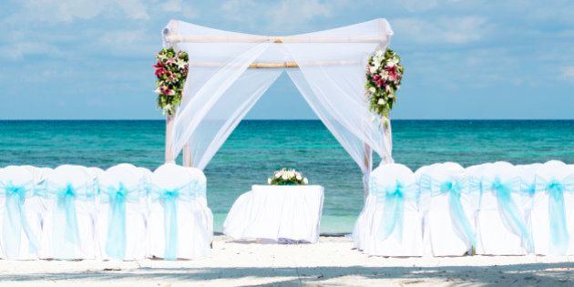 A wedding beach gazebo in a tropical location waiting for the bride and groom to