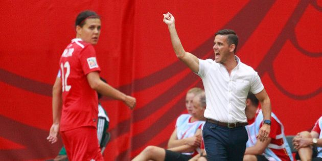 VANCOUVER, BC - JUNE 21: Christine Sinclair #12 of Canada looks on as Canada coach John Herdman yells...