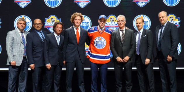SUNRISE, FL - JUNE 26: Connor McDavid poses on stage after being selected first overall by the Edmonton...