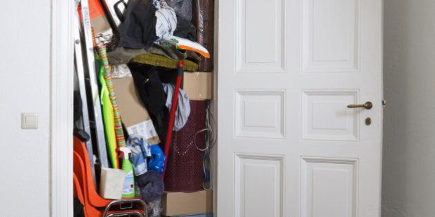 A closet stuffed with various storage